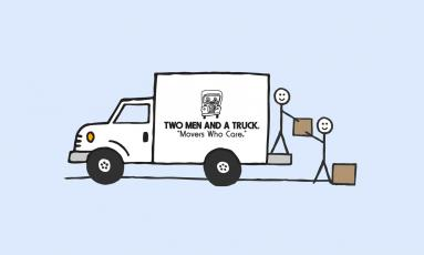 Two stick people load boxes into white cartoon moving truck